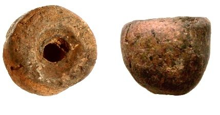 Plain spindle whorl of convex conical shape, height //cm, found during the Scavi Kleibrink 1991-2004 on the Timpone della Motta, 8th century BC, National Archaeological Museum, Sibari.